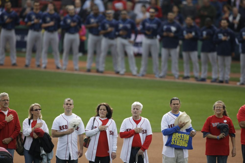 One of the few times many survivors of the Boston marathon bombing were together publicly was at Game 2 of the World Series in Boston. (AP/Stephan Savoia)