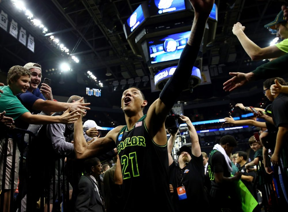 During March Madness, student-athletes like Baylor's Isaiah Austin become television stars. (Tom Pennington/Getty Images)