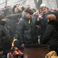U.S. Secretary of State John Kerry speaks wtih people as he stands not far from a barricade at the Shrine of the Fallen in Kiev on March 4, 2014. (Sergei Supinsky/AFP/Getty Images)