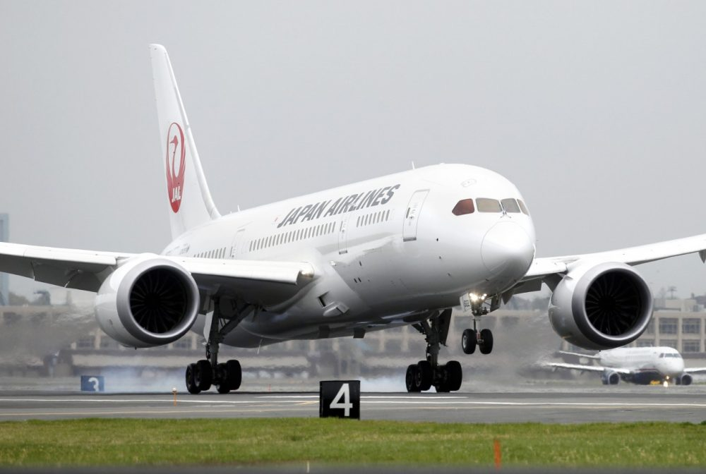 A Japan Airlines Boeing 787 lands at Logan International Airport in Boston on its inaugural, non-stop flight from Tokyo. (Michael Dwyer/AP)