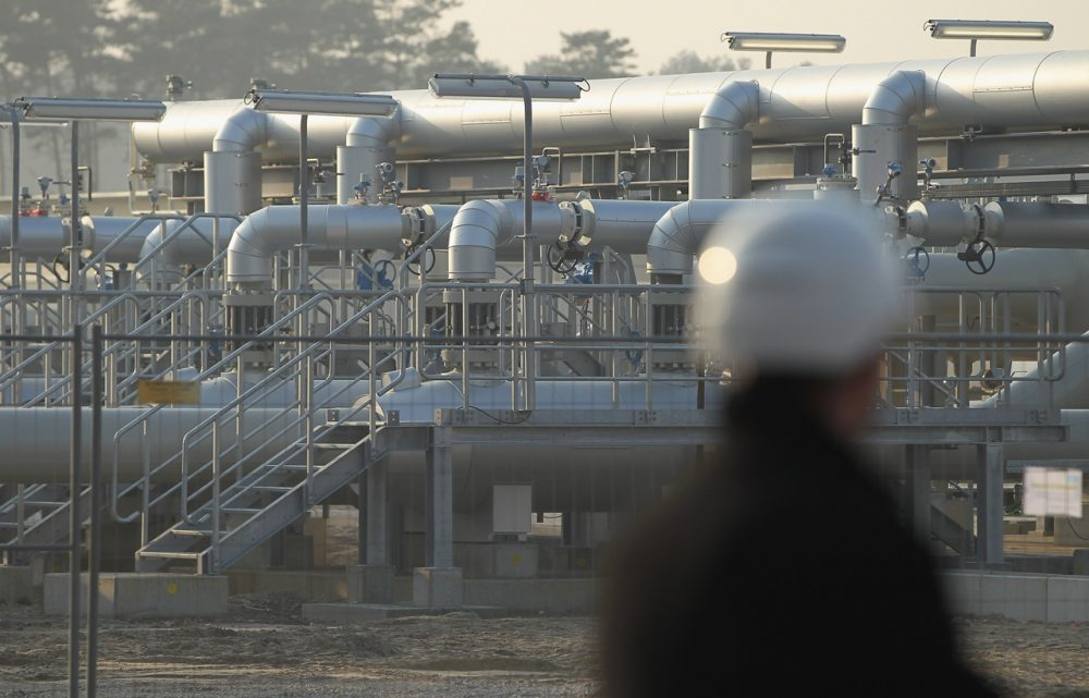 A man wearing a hard hat looks out at the central facility where the Nord Stream Baltic Sea gas pipeline reaches western Europe following the pipeline's official inauguration on November 8, 2011 in Lubmin, Germany. (Sean Gallup/Getty Images)