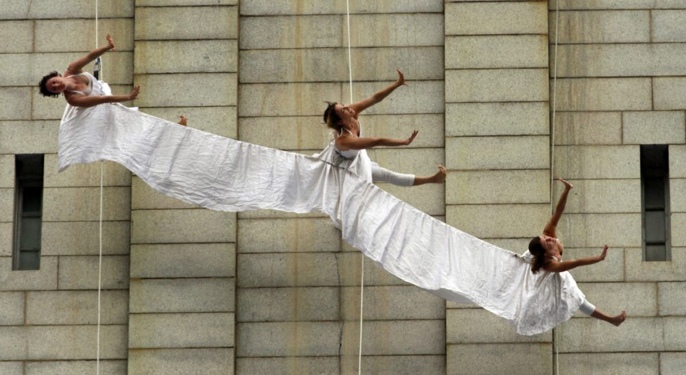 Aerial dancers rehearse while suspended on ropes on the wall of the Old Post Office Pavilion, home to the National Endowment for the Arts in Washington, on Wednesday, May 9, 2012. (Jacquelyn Martin/AP)