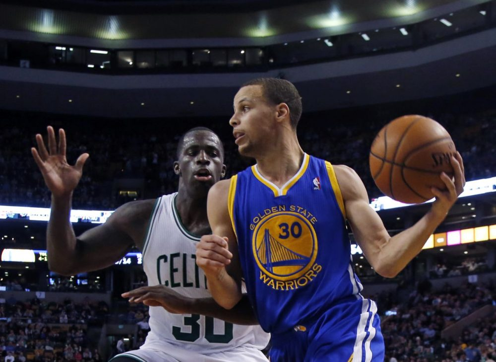 Golden State Warriors point guard Stephen Curry (30) controls the ball against Boston Celtics forward Brandon Bass (30). (AP/Elise Amendola)