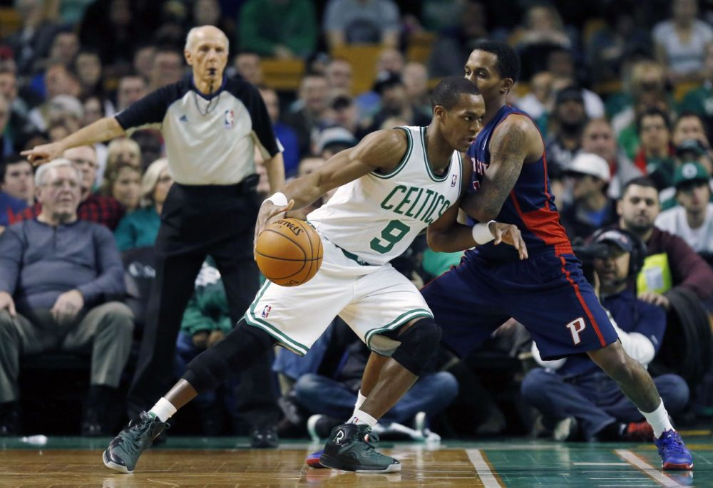 Boston Celtics' Rajon Rondo (9) drives past Detroit Pistons' Brandon Jennings (7) in the first quarter.  (AP/Michael Dwyer)