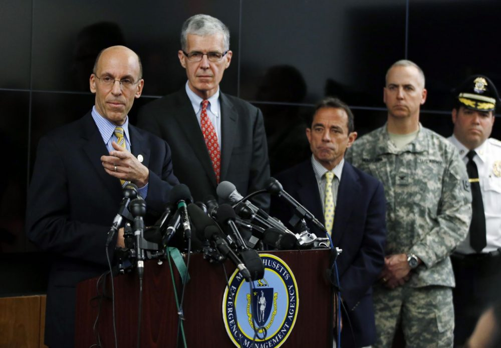 Massachusetts Emergency Management Agency Director Kurt Schwartz, left, details new security measures for the 2014 Boston Marathon on Monday. (Elise Amendola/AP)