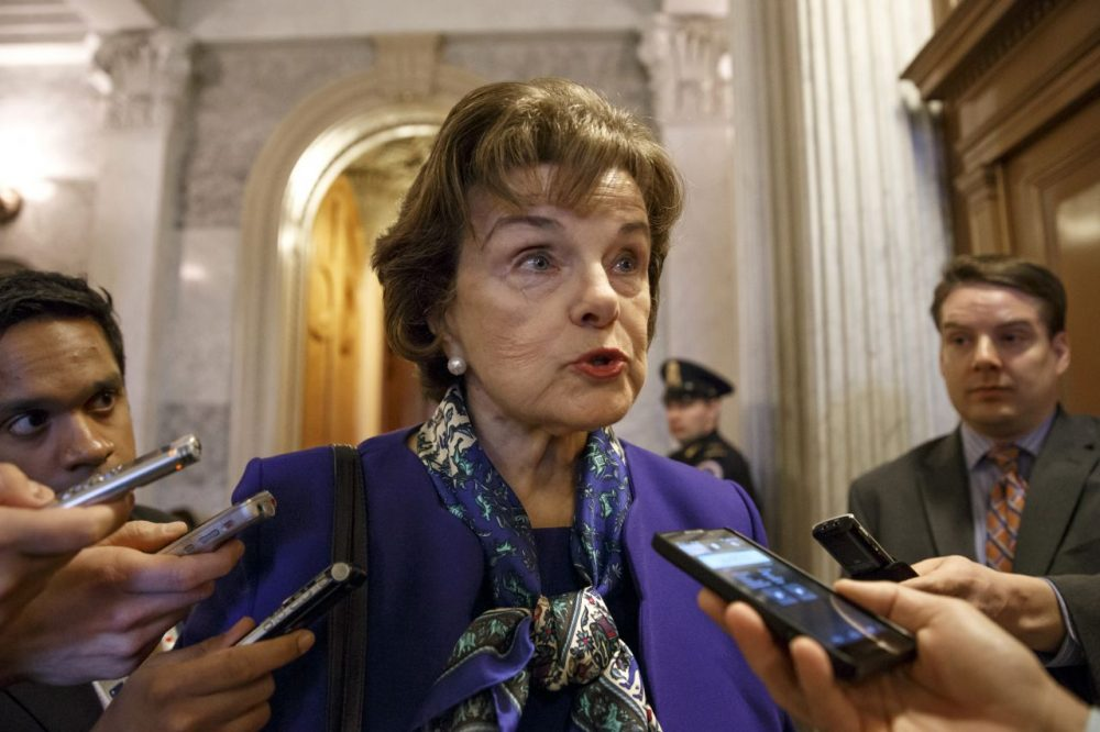 Senate Intelligence Committee Chair Sen. Dianne Feinstein, D-Calif. talks to reporters as she leaves the Senate chamber on Capitol Hill after saying that the CIA's improper search of a stand-alone computer network established for Congress has been referred to the Justice Department. (J. Scott Applewhite/AP)