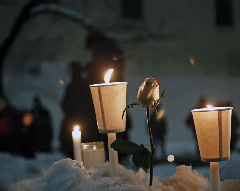 Candles burn alongside a rose left in a snowbank following a candlelight vigil for actor Philip Seymour Hoffman, who died of a drug overdose. (Kathy Willens/AP)