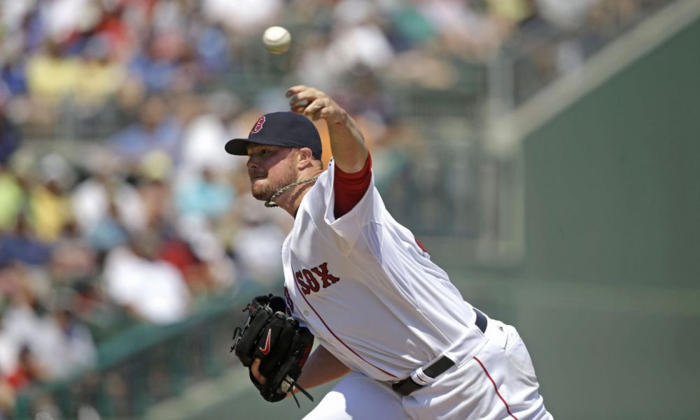 Boston Red Sox starting pitcher Jon Lester pitches in the first inning. (AP/Gerald Herbert)