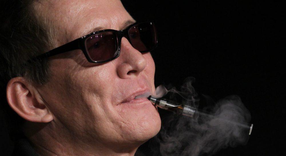 In this photo, Actor Thomas Bo Larsen smokes an electronic cigarette during a press conference for The Hunt at the 65th international film festival, in Cannes, France, Sunday, May 20, 2012. (Francois Mori/AP)