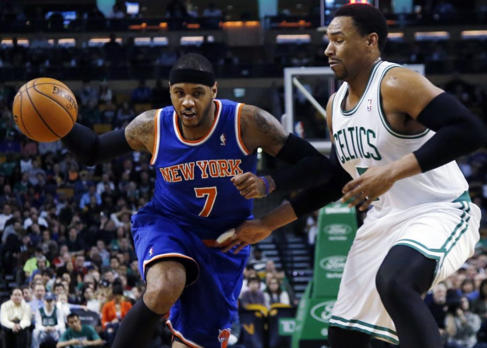 New York Knicks forward Carmelo Anthony, left, drives against Boston Celtics center Jared Sullinger. (AP/Elise Amendola)
