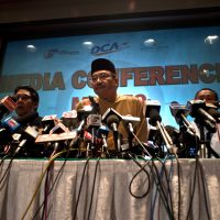 Malaysia's Minister of Defence and Acting Transport Minister, Hishammuddin Hussein gestures as he answers questions from journalists at a hotel near Kuala Lumpur International Airport in Sepang on March 14, 2014.  (Manan Vatsyayana/AFP/Getty Images)
