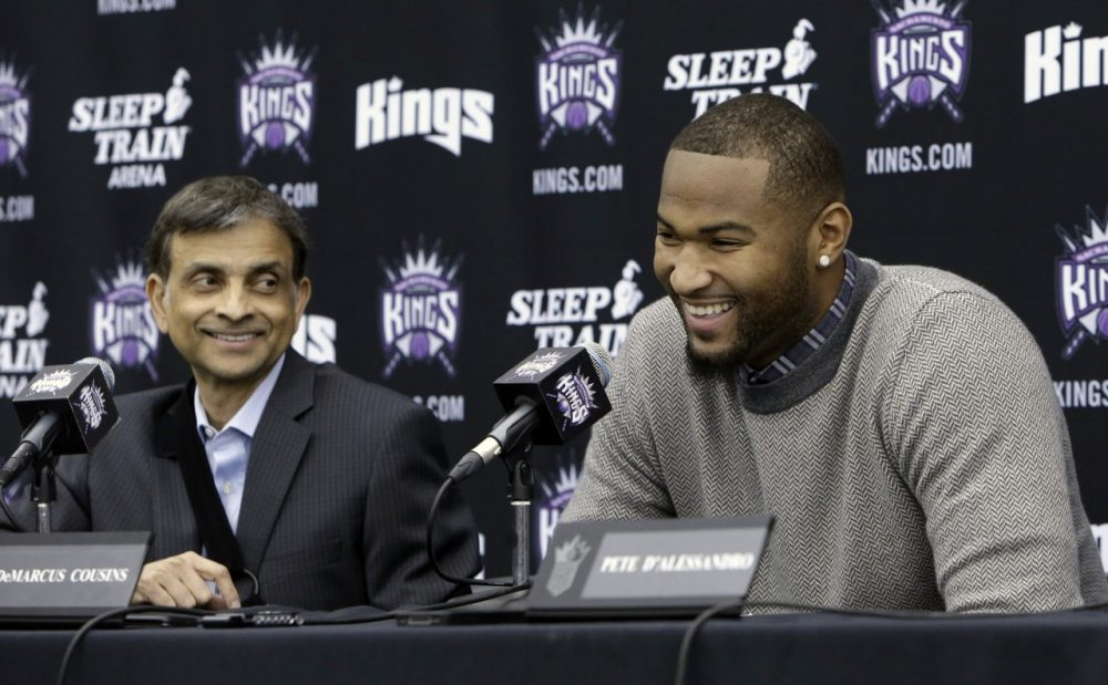 Vivek Ranadive (left) said the first call he made after purchasing the Sacramento Kings was to center DeMarcus Cousins (right). (Rich Pedroncelli/AP)
