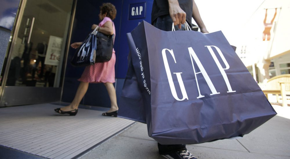 In this Aug. 9, 2009, file photo, a shopper leaves a Gap store in Palo Alto, Calif. The nation's largest clothing chain, which operates, Gap, Old Navy, Banana Republic and Athleta, said it would raise the wages to $10 by 2015. (Paul Sakuma/AP)