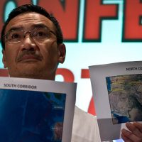 Malaysia's Minister of Defence and Acting Transport Minister, Hishammuddin Hussein shows maps during a press conference at a hotel near Kuala Lumpur International Airport in Sepang on March 17, 2013. An investigation into the pilots of missing Malaysia Airlines flight 370 intensified on March 17 after officials confirmed that the last words spoken from the cockpit came after a key signalling system was manually disabled. (Photo credit should read Manan Vatsyayana/AFP/Getty Images)