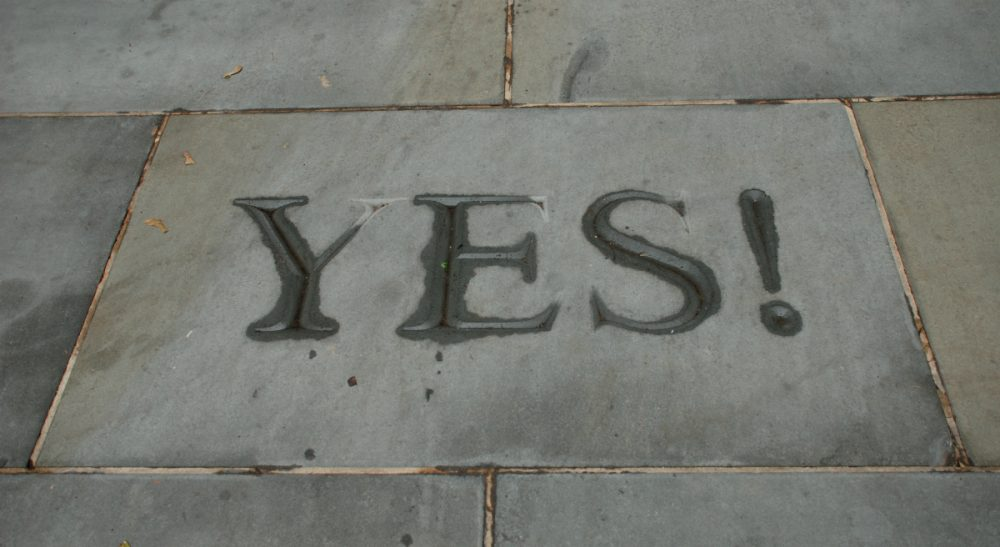 "The word ""Yes!"" is etched into the stone walk at the entrance to Hargadon Hall at Princeton University. The building was named for longtime dean of admissions Fred Hargadon. During Hargadon's tenure, acceptance letters were legendary for beginning with the single word, ""Yes!"" (Joe Shlabotnik/flickr)"