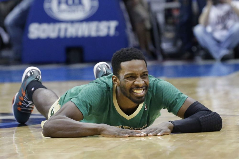 Boston Celtics forward Jeff Green lays on the floor after a turn over. (AP/LM Otero)