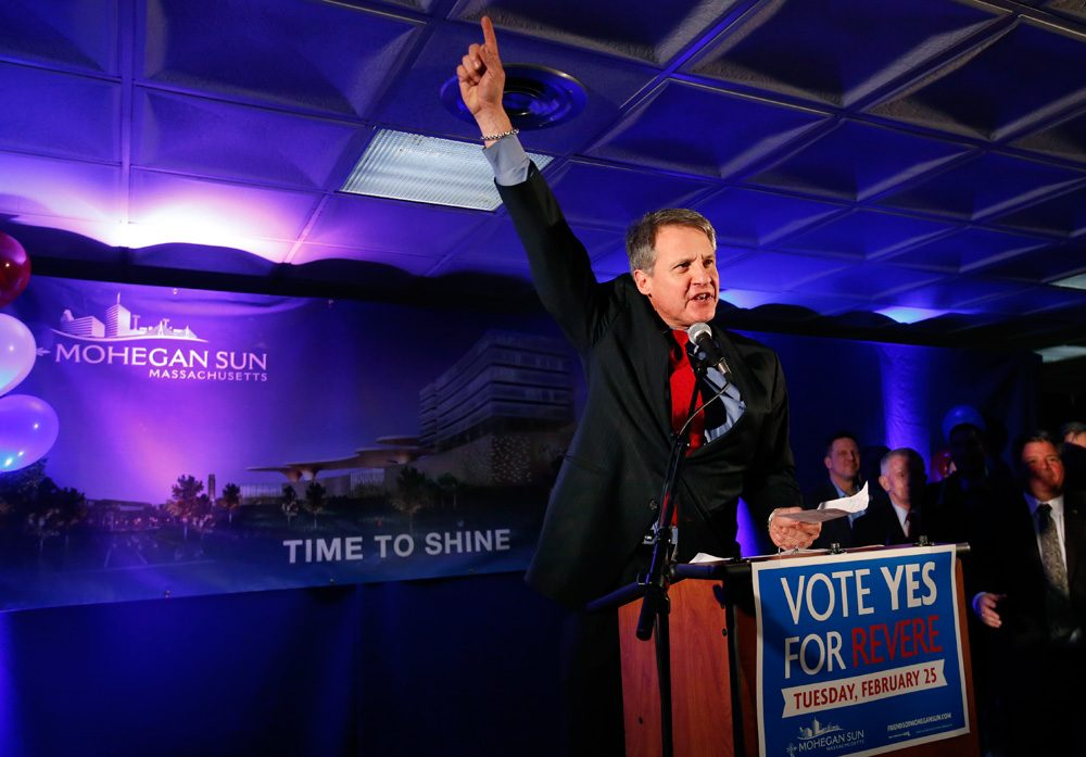 On Feb. 25, Mohegan Sun CEO Mitchell Etess celebrates the passage of a referendum allowing the casino operator to move forward with its plan at Suffolk Downs in Revere. A new WBUR poll finds declining support for casinos in the state. (Elise Amendola/AP)
