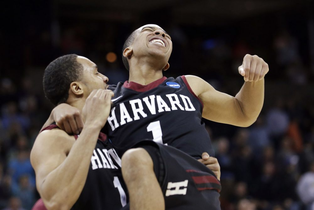 Harvard's Siyani Chambers, right, leaps into the arms of teammate Brandyn Curry after the team beat Cincinnati. (Elaine Thompson/AP)