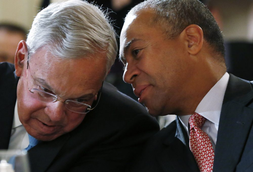 Former Boston Mayor Thomas Menino, left, and Gov. Deval Patrick huddle prior to their speeches at a forum Monday on lessons learned from the response to last year's Boston Marathon bombings. (Elise Amendola/AP)