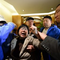 Angry relatives of missing passengers on Malaysia Airlines flight MH370 weep after hearing the news that the plane plunged into Indian Ocean at a hotel in Beijing on March 24, 2014. The missing Malaysia Airlines jet came down in the Indian Ocean, Prime Minister Najib Razak said March 24, as the airline reportedly told relatives it had been lost and that none on board survived.(Goh Chai Hin/AFP/Getty Images)