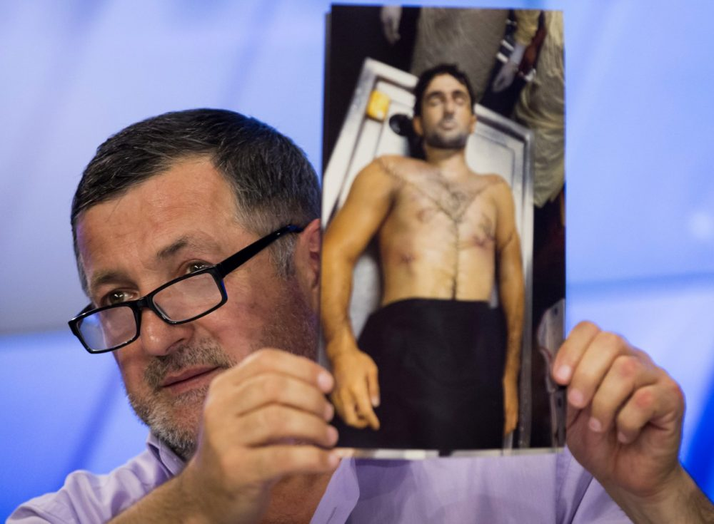 Abdul-Baki Todashev holds a photo he claims is of his dead son Ibragim Todashev. (Alexander Zemlianichenko/AP)
