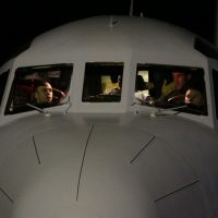 The cockpit crew of a Royal Australian Air Force AP-3C Orion are seen upon their return to RAAF base Pearce from searching for the missing Malaysian Airlines flight MH370 over the southern Indian Oceanat in Bullsbrook on March 26, 2014. Planes and ships converged on the southern Indian Ocean on March 26, resuming the hunt for wreckage from Malaysia Airlines Flight MH370 after weather conditions improved. (Jason Reed/AFP/Getty Images)