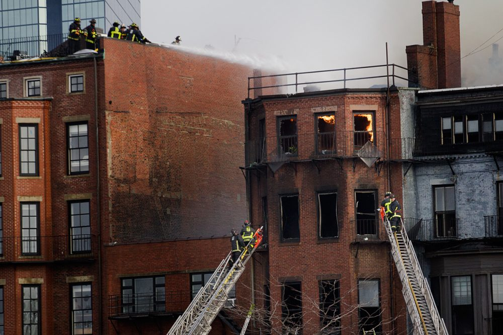 The Wednesday afternoon fire killed two firefighters and left 13 others injured.