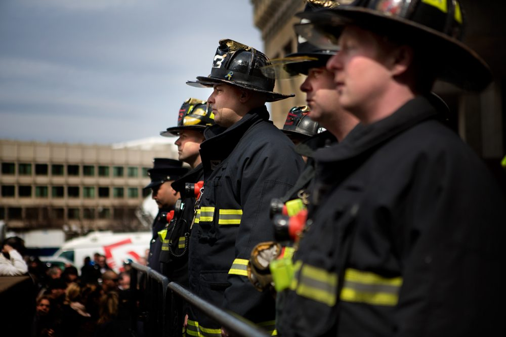 Hundreds gathered on City Hall Plaza Friday afternoon to honor two fallen firefighters. (Jesse Costa/WBUR)