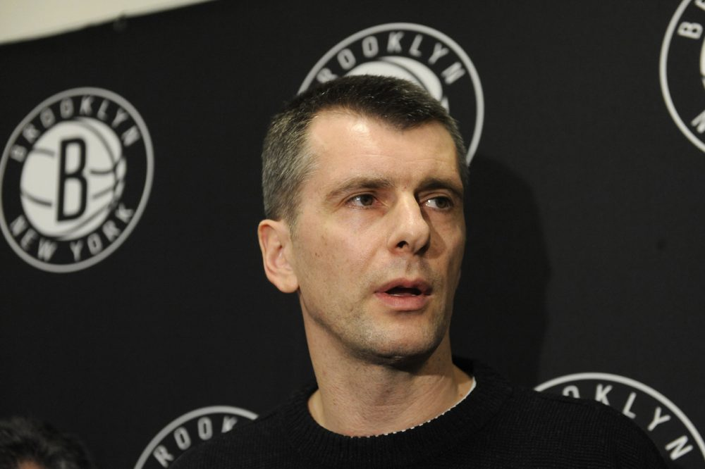 Russian billionaire and Brooklyn Nets owner Mikhail Prokhorov has announced plans to transfer ownership of the basketball team to one of his Russian companies, but it's unclear whether or not the NBA will allow it. (Kathy Kmonicek/AP Photo)
