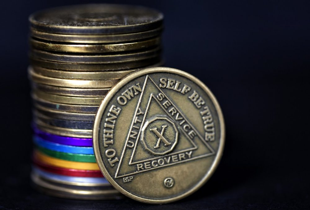 The chips AA members receive to mark sobriety. (Randy Heinitz/Flickr)