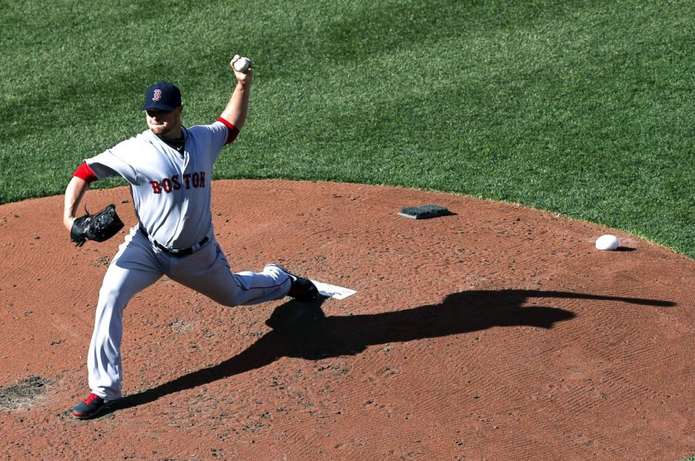 Boston Red Sox starting pitcher Jon Lester throws to the Baltimore Orioles in the fourth inning of an opening day baseball game in Baltimore. (Patrick Semansky/AP)