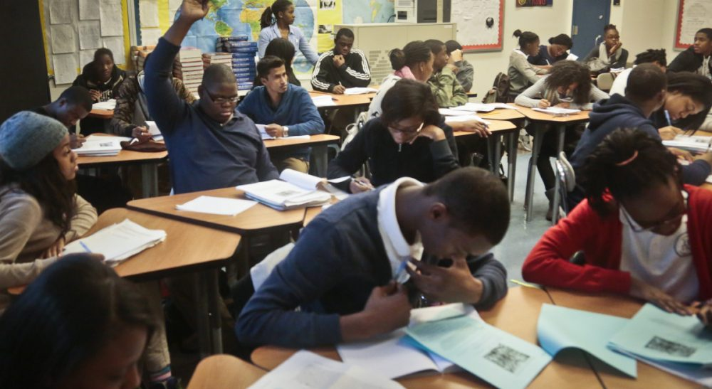 A Global Studies class of 10th and 11th graders work at Bedford Academy High School on Tuesday, Dec. 3, 2013 in New York. (Bebeto Matthews/AP)
