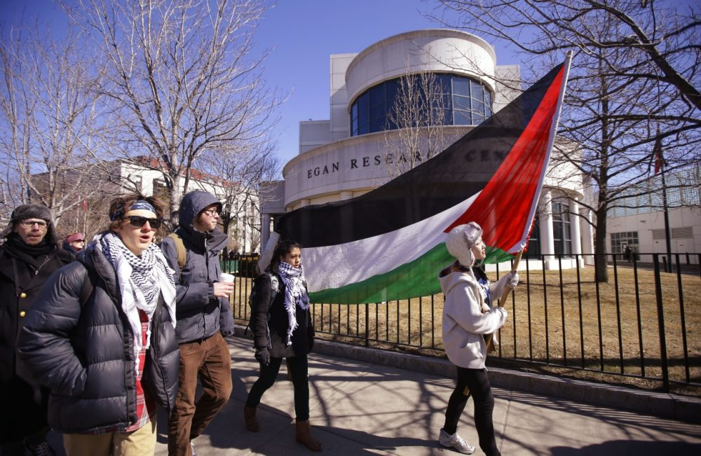 "Students and supporters march across campus during a protest in support of Palestine after a Northeastern University student organization, Students for Justice in Palestine, was ""temporarily suspended for multiple violations of university policy over an extended period of time,"" according to a university statement in Boston, Tuesday, March 18, 2014. (AP)"