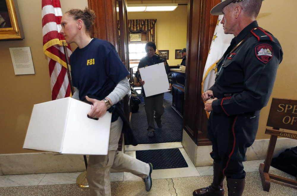 FBI investigators leave the office of Rhode Island House Speaker Gordon Fox at the State House in Providence, R.I. (Michael Dwyer/AP)