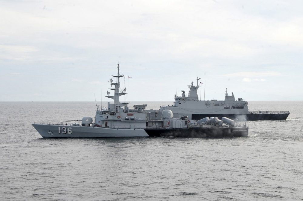 In this photo released by The Royal Malaysian Navy, Royal Malaysian Navy's missile corvette KD Laksamana Muhammad Amin, front, and Royal Malaysian Navy's offshore patrol vessel KD Selangor are seen during a search and rescue operation for the missing Malaysia Airlines plane over the Straits of Malacca, Malaysia, Thursday, March 13, 2014. (AP)