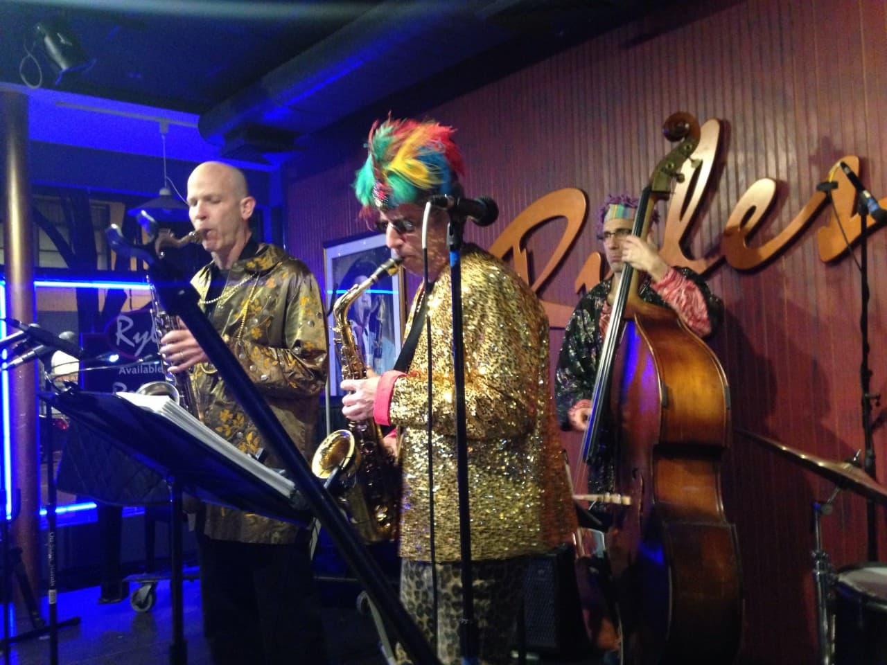 Tom Hall, Ken Field and Blake Newman of Revolutionary Snake Ensemble play at Ryles Jazz Club in Cambridge, Mass. (WBUR/Kathleen McNerney)