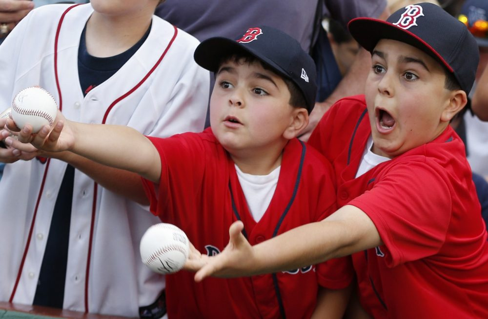 Young fans vie for autographs before a doubleheader between the Boston Red Sox and the Los Angeles Angels in 2013. (AP/Michael Dwyer)
