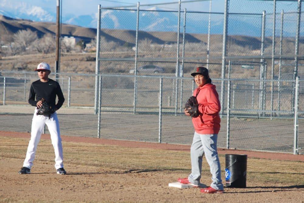 Players for Naat'aanii, a team created for Navajo youth, practice in Farmington, N.M., beneath Colorado's La Plata Mountains. (Ken Shulman/OAG)