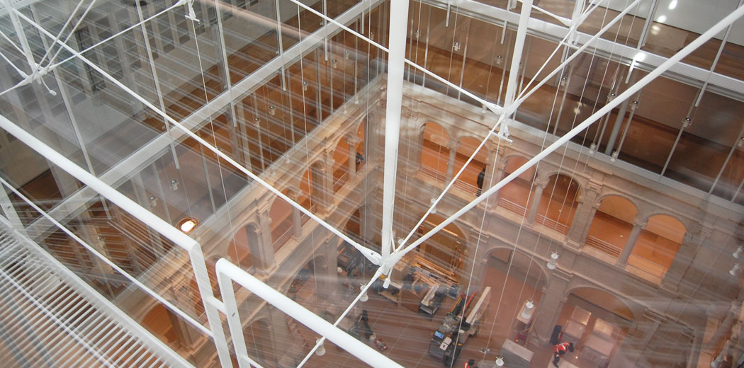Looking down from the glass-roofed atrium to the courtyard floor five stories below. (Greg Cook)
