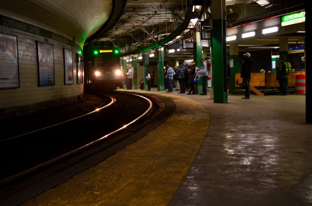 A Green Line trolley arrives at the Government Station MBTA station on Thursday. (Sharon Brody/WBUR)