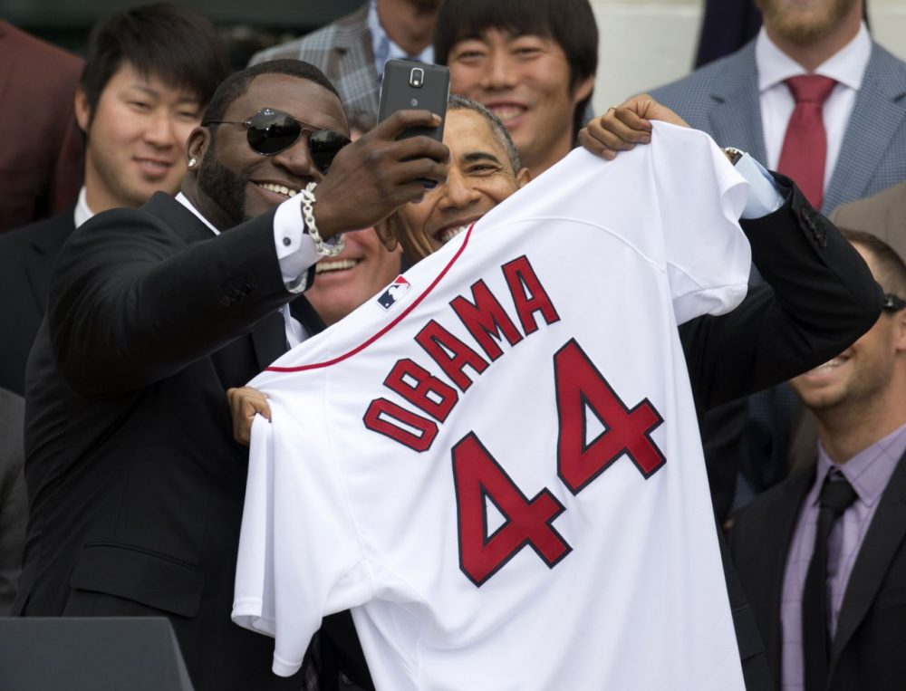 "David ""Big Papi"" Ortiz presented President Barack Obama with a Red Sox jersey on the South Lawn of the White House. (Carolyn Kaster/AP)"
