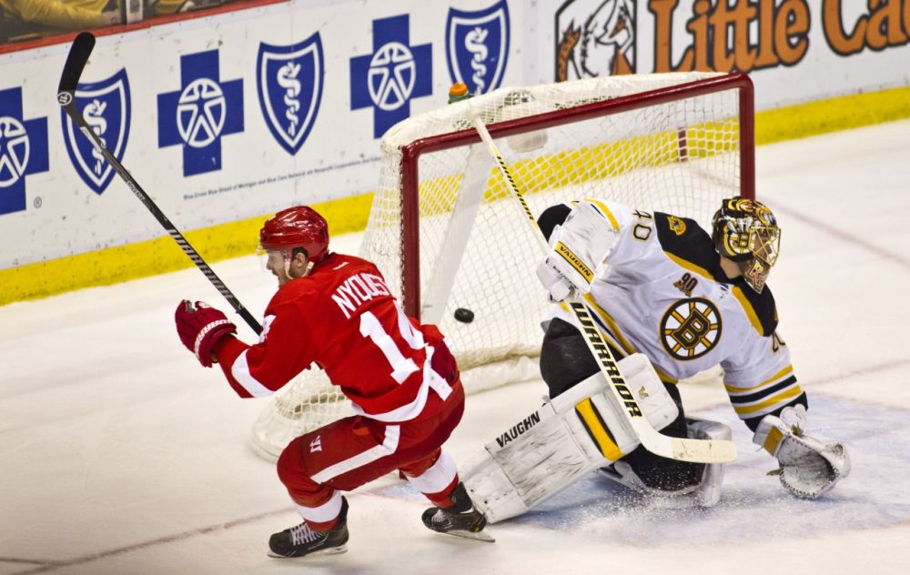 Detroit Red Wings forward Gustav Nyquist (14) scores the game-winning goal against Boston Bruins goalie Tuukka Rask (40), of Finland, during the third period of Wednesday's game in Detroit, Mich. The Red Wings won 3-2. (AP Photo/Tony Ding)