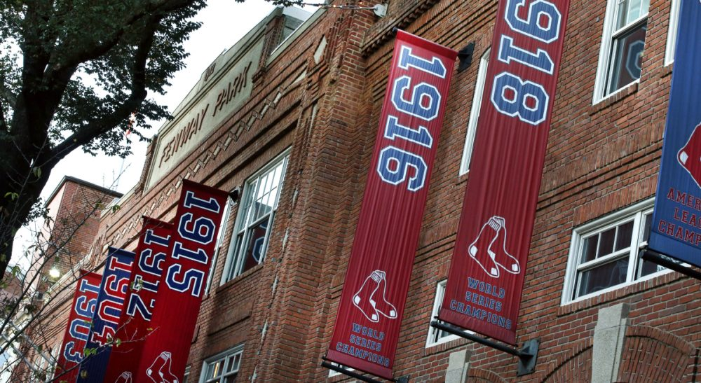 Championship banners hang on the facade of Fenway Park in Boston on Tuesday, Oct. 29, 2013. (Elise Amendola/AP)