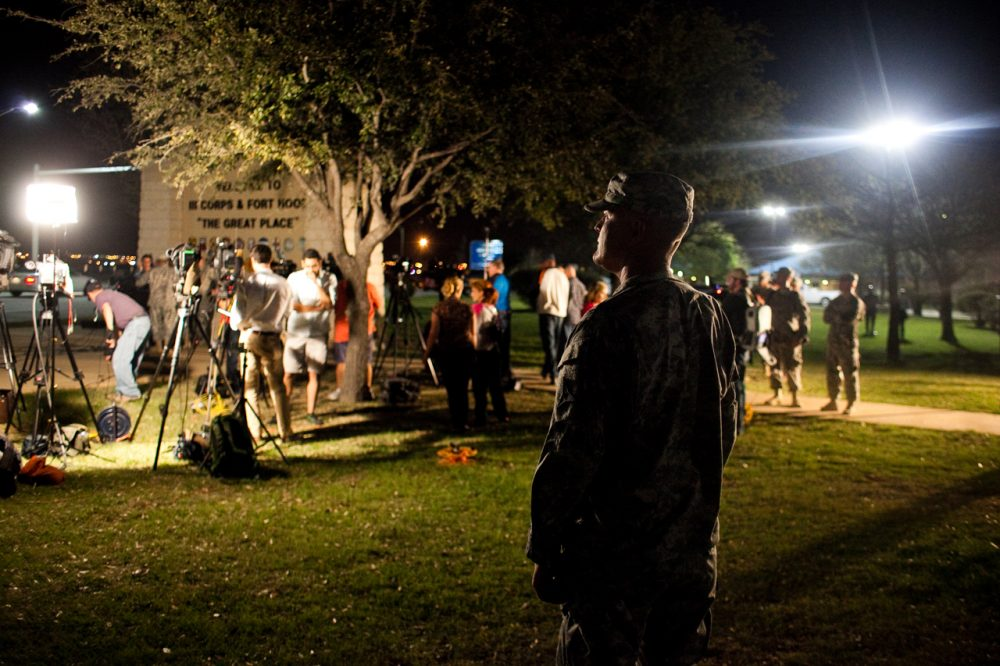A soldier watches over media as they prepare to hear General Mark Milley, III Corps and Fort Hood Commanding General, speak during a press conference about a shooting that occurred earlier in the day at Fort Hood Military Base on April 2, 2014 in Fort Hood, Texas.  Milley confirmed that four people were dead in the shooting, including the gunman himself. (Drew Anthony Smith/Getty Images)