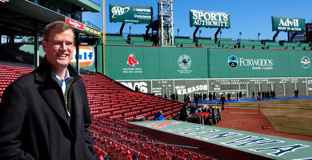 Sam Kennedy, chief operating officer for the Red Sox talks about the green grass and the real green ahead of Friday's season opener. (WBUR)