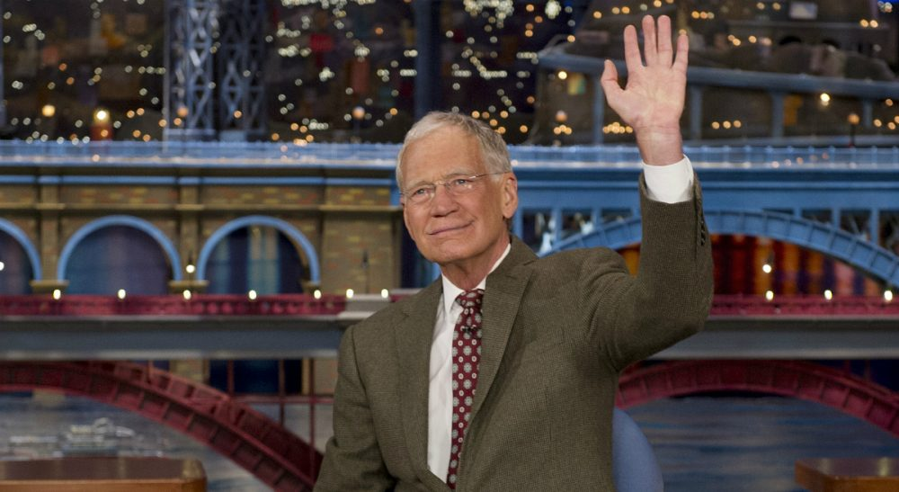 "In this photo, David Letterman, host of the ""Late Show with David Letterman,"" waves to the audience in New York on Thursday, April 3, 2014, after announcing that he will retire sometime in 2015. Letterman, 66, has the longest tenure of any late-night talk show host in U.S. television history, already marking 32 years since he created ""Late Night"" at NBC in 1982. (Jeffrey R. Staab/AP)"