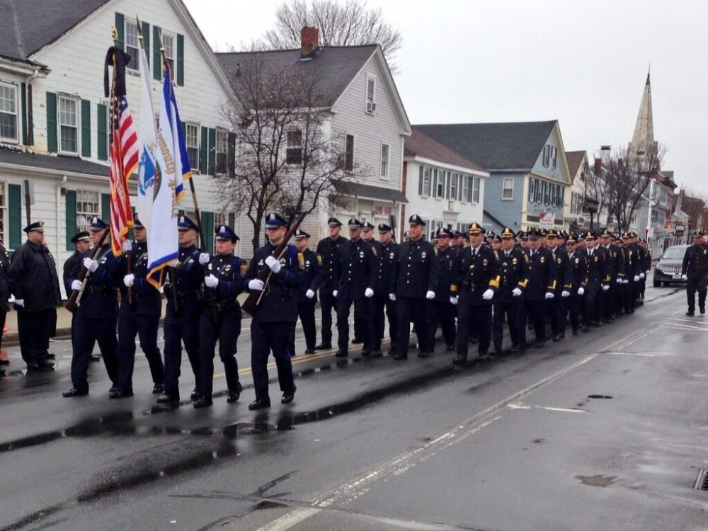 The Plymouth Police Department marches to Greg Maloney's funeral service. (Mass. State Police)