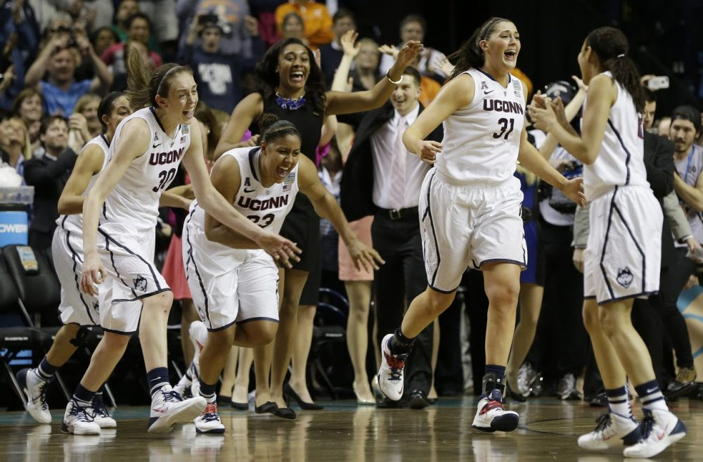 Connecticut players leave the bench after the second half of the championship game against Notre Dame. (Mark Humphrey/AP)