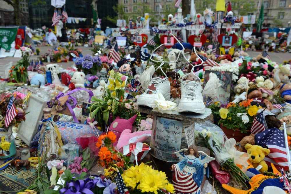 Memorials to the victims of the 2013 Boston Marathon Bombing like this one on Boylston street, sprung up all over the city. (Darren McCollester/Getty Images)