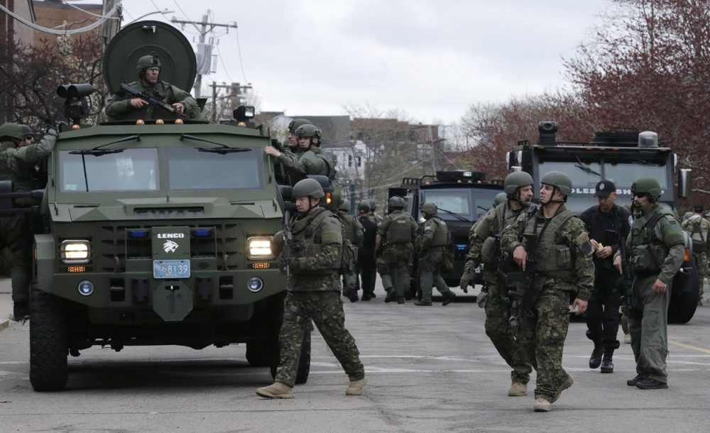 A SWAT team unloaded from their armored vehicles on April 19. 2013. (Charles Krupa/AP)